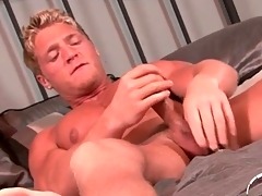 Husky smooth blonde guy jerks off onto his stomach