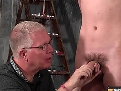 Grown up BDSM master gives twink a handjob