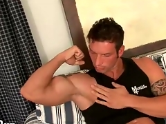 Robust guy gets naked with an increment of kisses his biceps