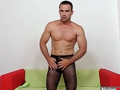 Robust beggar in pantyhose fucks a toy